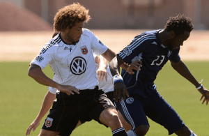 D.C. United's Nick DeLeon battles Sporting K.C.'s Kei Kamara for position during the preseason. (Photo: Joshua Pearson)