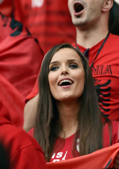 An Albania supporter cheers for her team ahead of the Euro 2016 group A football match between Albania and Switzerland at the Bollaert-Delelis Stadium in Lens on June 11, 2016. / AFP PHOTO / PHILIPPE HUGUEN