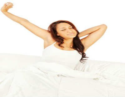 The image shows a woman waking up.