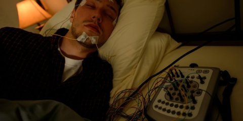 The image shows a test participant sleeping.