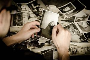 This image shows a person looking at old photos.