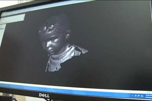 The image shows a 3d image of a child's face generated by the computer software.