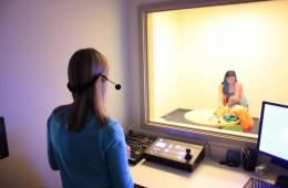 Image shows the researcher watching a mom and child.