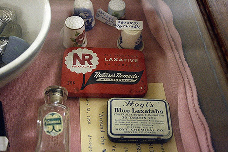 Image shows vintage laxative tins.