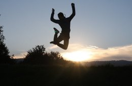 Image shows a person jumping and having fun.