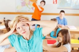 Image shows a teacher and a class full of kids.