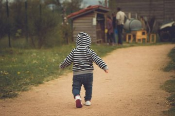 Image shows a baby walking.