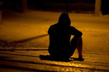 Image shows a depressed looking man.