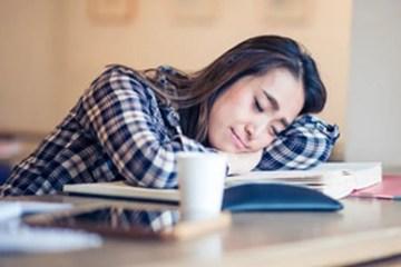 Image shows sleeping woman.