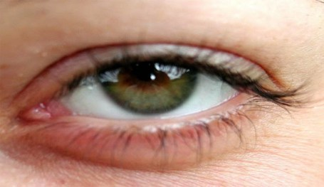 A close up picture of a hazel green woman's eye.