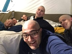 Photo courtesy of the Bald Barons: The six members of Bald Barons, a participating team in the St. Jude Children's Research Hospital fundraiser, Up 'til Dawn, take a selfie while getting settled in their tent on Monday, March 31, the first night of their campout in front of the Joe Crowley Student Union. The team shaved their heads and raised over $5,000 for St. Jude prior to their camp out at the Up 'til Dawn event on Sunday, March 28.