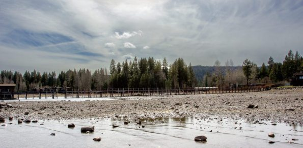 Breanna Denney /Nevada Sagebrush Extreme drought conditions reveal rocks where water used to be at Commons Beach in Tahoe City, CA on March 21, 2015. California Gov. Jerry Brown recently declared a statewide mandate to cut back on water usage.