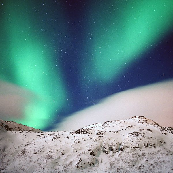 Art photography: Northern Lights with snowy mountain