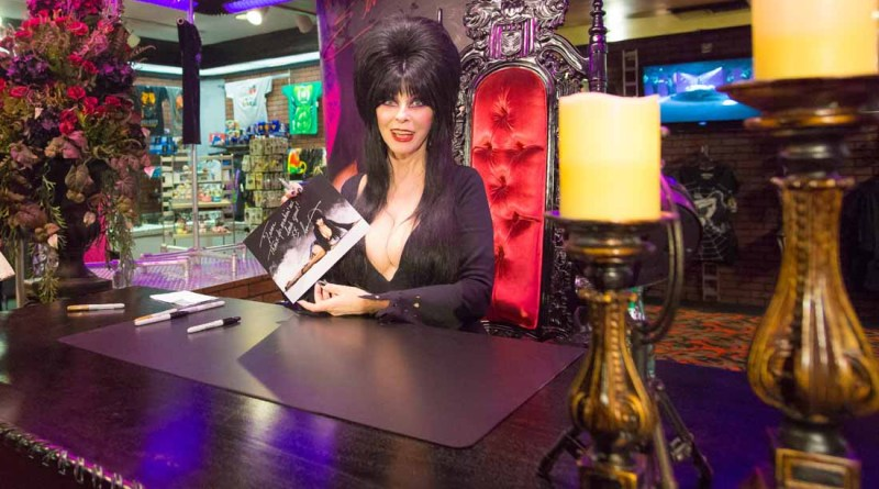 Get an autographed photograph of the Mistress of the Dark in Elvira's Boo-tique at Knotts Scary Farm.