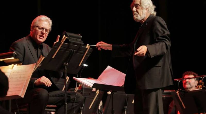 Bruce Boxleitner works himself into a state while Rubinstein calmly conducts.