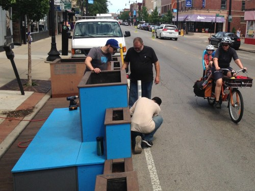Brian Bonanno, in baseball cap, and contractors reinstall the Farragut People Spot. Photo: John Greenfield