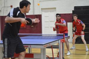 Alex Figueroa from Newport Beach Table Tennis serving to USC Team from Los Angeles