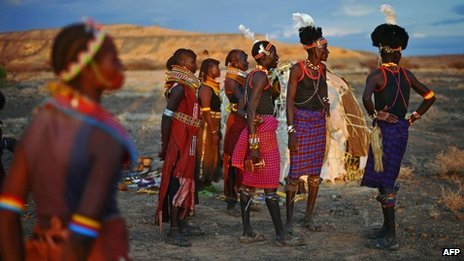 Men and women from the Turkana tribe take part in a ceremony in the Sibiloi national Park in the Turkana region