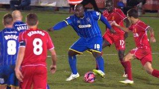 AFC Wimbledon striker Adebayo Akinfenwa aka 'The Beast' in action against Liverpool