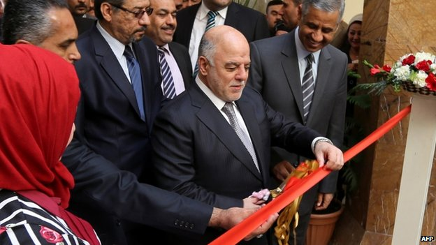 Iraqi Prime Minister Haider al-Abadi (C) attends the reopening ceremony of Iraq's national museum on February 28, 2015