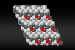 Artist's rendering of the nickel-gallium active site, which synthesizes hydrogen and carbon dioxide into methanol. Nickel atoms are light grey, gallium atoms are dark grey, and oxygen atoms are red. Credit: Jens Hummelshoj/SLAC