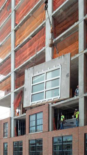 Facade panels are installed onto the building