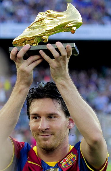Barcelona's Argentinian forward Lionel Messi displays his Bota de Oro 2010' trophy awarded as the best European player on October 3, 2010 prior to their first league football match against Mallorca at Camp Nou Stadium in Barcelona. AFP PHOTO/ JOSEP LAGO (Photo credit should read JOSEP LAGO/AFP/Getty Images)