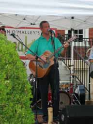 Governor O'Malley serenades guests at the 2012 Buy Local Cook Out at Government House