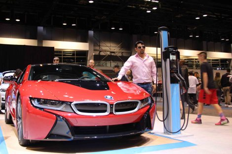 """Electric vehicles and hybrid vehicles enjoy huge popularity during the show, but some attendees say they're too expensive. This BMW i8 runs $141,695. """"I can buy my house with this amount of money,"""" says one visitor. (Yemeng Yang/MEDILL)"""