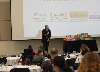 John Evans delivers he keynote speech during the 2013 Overcoming Barriers to Employment Summit