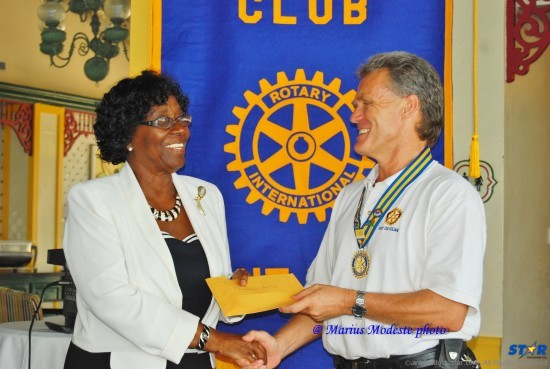 Rotary Club President Konrad Wagner making presentation to Governor General Dame Pearlette Louisy.