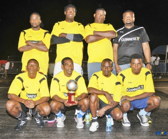 Platinum FC pictured with Guinness Brand Manager, Sylvester Henry. The team placed third at the Regional Guinness Street Challenge finals.