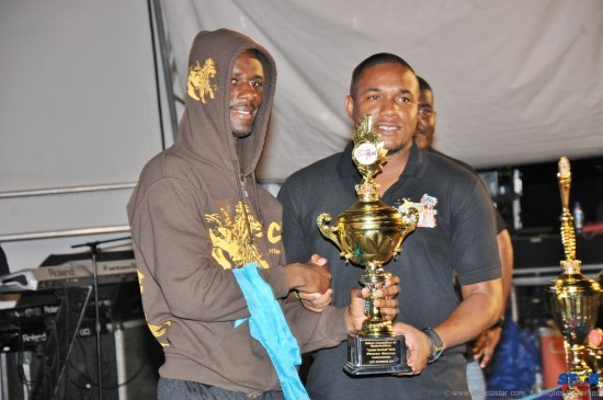 Brand Manager Rohan Lovence presents DJ HP with the third place trophy.