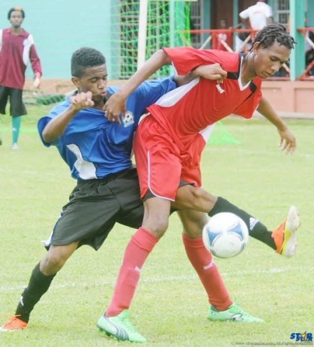 By all means necessary a Central Castries defender tries taking the ball away from an Anse la Raye player in a game played in the Royal Club Under-20 Tournament.