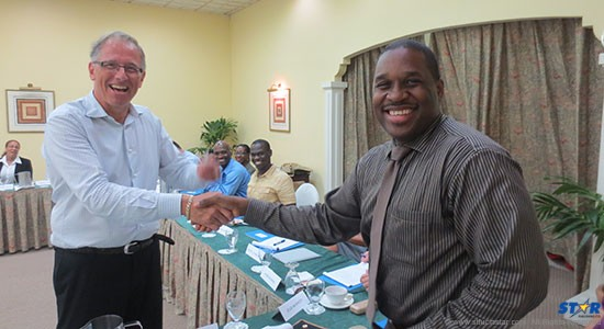 Dr. Chris Bart presents Tourism Director Louis Lewis with a brand new Samsung Galaxy III raffled by seminar sponsor LIME.