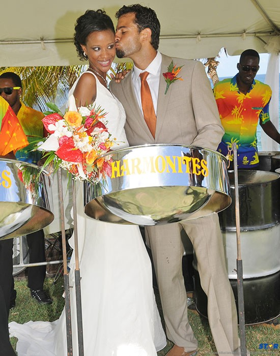 """""""Bride"""" & model,  Denise Lay, celebrates with """"Groom"""" & swimming coach, Jamie Peterkin after the 'mock' wedding at Pigeon Island National Park."""