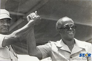 The last time Prime Minister Allan Louisy (right) and his deputy George Odlum pressed the flesh. The public handshake was inspired by trade unionist Tyrone Maynard at a Labour Day function  at Mindoo Phillip Park. Alas, it turned out not to be all right in the morning!