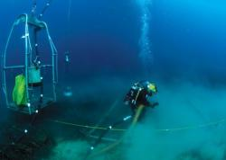 Navy Diver assigned to Mobile Diving and Salvage Unit (MDSU) 2, Company 4, operates a suction dredge system during an underwater recovery operation in search of a missing service member on 6 October in the Mediterranean Sea. U.S. Navy