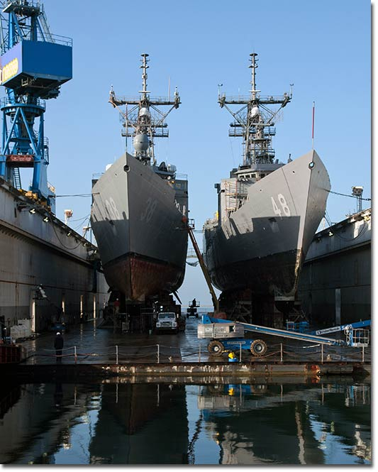 Two Oliver Hazard Perry-class (FFG-7) frigates undergo maintenance at NASSCO's San Diego shipyard. NASSCO Photo