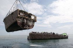 US Navy contracted crane vessel M/V Jascon 25 removes the bow of the mine countermeasure ship Ex-Guardian (MCM 5) on March, 26 2013. US Navy Photo