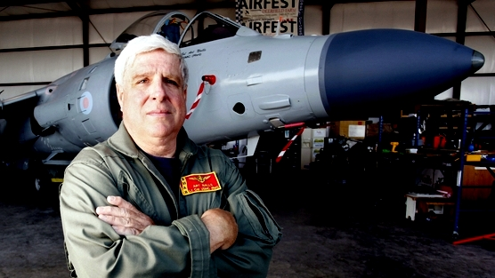 Former US Marine Lt. Col. Art Nall with his restored Sea Harrier. Since military teams have canceled air shows dates due to budget cuts, Nall has seen increased demand for struggling air shows. 