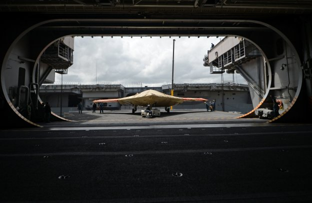 An X-47B Unmanned Combat Air System (UCAS) demonstrator sits on an aircraft elevator of the aircraft carrier USS George H.W. Bush (CVN-77) on May 6.