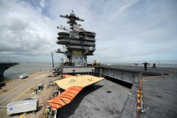 Northrop Grumman&#039;s X-47B is loaded Monday onboard the USS George H.W. Bush (CVN-77) for a planned May, 14 2013 catapult launch. US Navy Photo