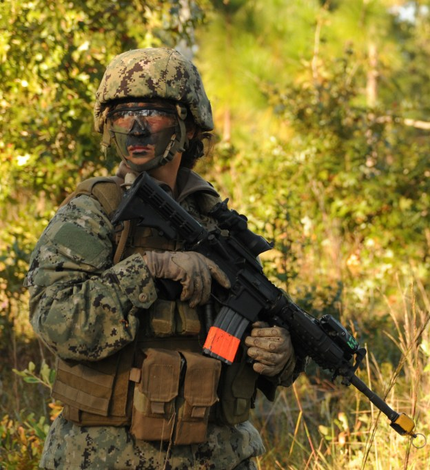 Chief Engineman Patricia Cooper, a student in the Riverine Combat Skills course (RCS), patrols the training grounds during a field training exercise in Camp Lejeune, N.C. in 2012. US Navy Photo
