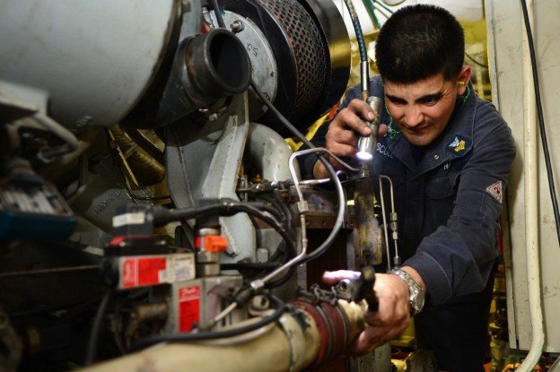 A sailor troubleshoots a ship's service diesel generator aboard the Freedom on July 20. US Navy Photo