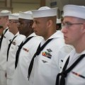 Sailors assigned to Naval Branch Health Clinic at Naval Support Activity, Bahrain, wait for a uniform inspection on June, 17 2013. US Navy Photo