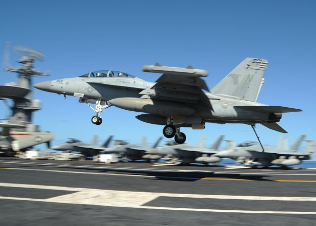 "An EA-18G Growler from the ""Shadowhawks"" of Electronic Attack Squadron (VAQ) 141 prepares to make an arrested landing on the flight deck of the U.S. Navy's forward-deployed aircraft carrier USS George Washington (CVN-73) in 2013 US Navy Photo"