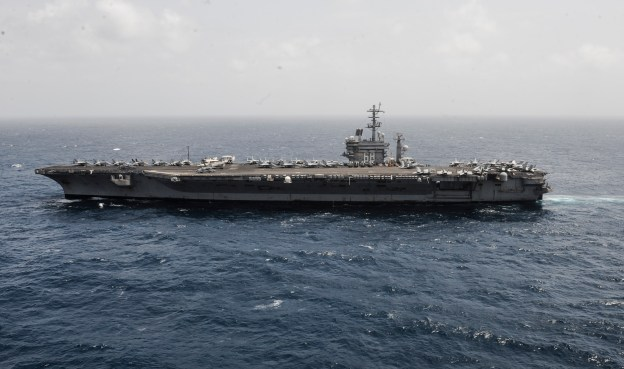 The aircraft carrier USS Nimitz (CVN-68) transits the Arabian Sea on Aug 29, 2013. US Navy Photo