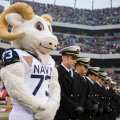 Naval Academy mascot Bill the Goat stands with midshipmen during the 2012 Army-Navy Game. US Navy Photo