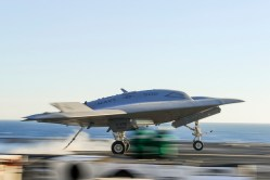 A X-47B lands on Nov. 10 onboard the USS Theodore Roosevelt (CVN-71). US Navy Photo